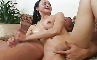 older oriental chick with worthy breast gives