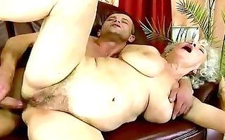 hawt breasty granny receives fucked on the sofa