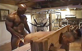 large dark muscle chap is banging his bondaged