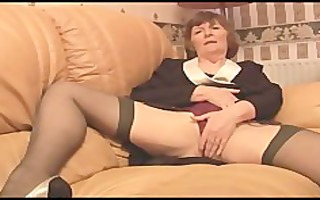 curly granny in nylons plays with pants then