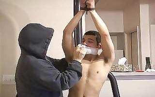 bound chap is gagged by a stranger in advance of