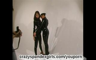 lesbo duett posing in shiny lycra (clip)