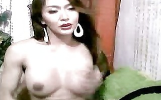 oriental lady-man plays with her wang