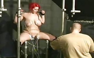 electrifying redhead bondage