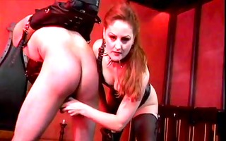 leather wearing mistresse spanks guys ass