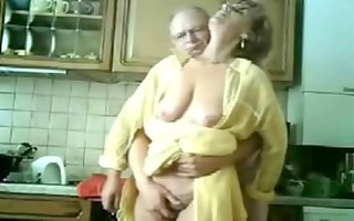 mom and dad having pleasure in the kitchen.