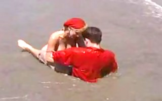 sally layd on the beach in retro clip