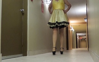 sissy ray in hotel corridor in sissy costume and