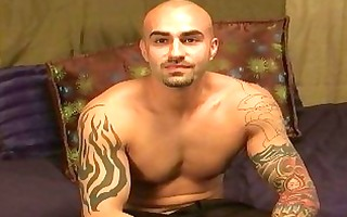 tattooed and muscular homo hunk shows off his