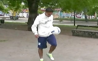darksome homosexual hunk plays football outdoors
