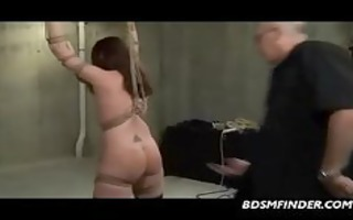 tied to bamboo and getting a caning