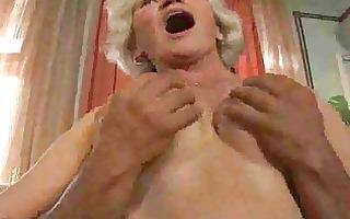 older granny puts knob in her throat