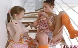 lesbo allies dildoing on the stairs