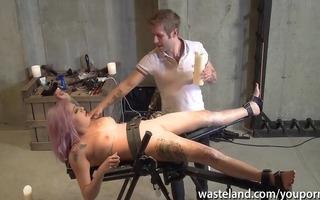 sexy wax fetish with a restrained sex bondman