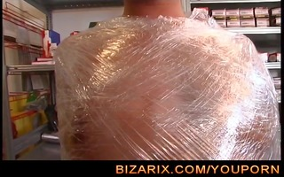 way-out girl complete wrapped in plastic