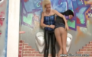 lesbian babes acquires slimed at the gloryhole