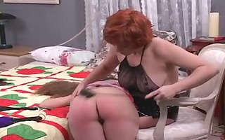 cute lesbian whore female-dominant spanks the