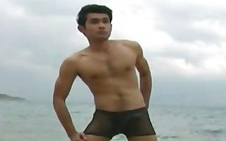 oriental gay chap posing in pants