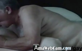 older man likes to engulf cock of younger -