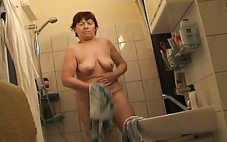 russian older fully s garb in bathroom