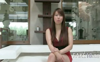 asian babe with big tits sexing on sofa