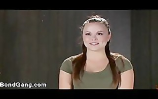 shackled brunette hair chick double penetration