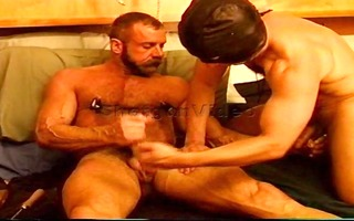two muscle chaps have a mutual ball squeezing and