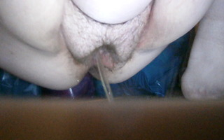 pissing cum-hole in shopping center parking abode