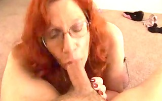 older redhead receives a jizz flow on her large