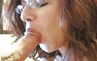redhead momma with massive tits and glasses gives