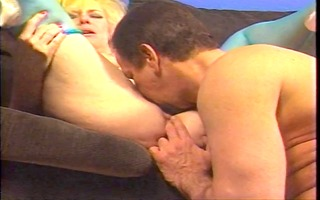 breasty aged blonde in thigh-highs kneels to