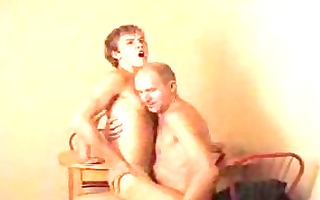 blond twink rides gay daddys cannon on chair