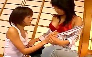 oriental cutie getting her fake weenie rubbed