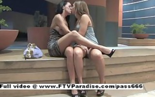 enjoyable pretty lesbos giving a kiss and